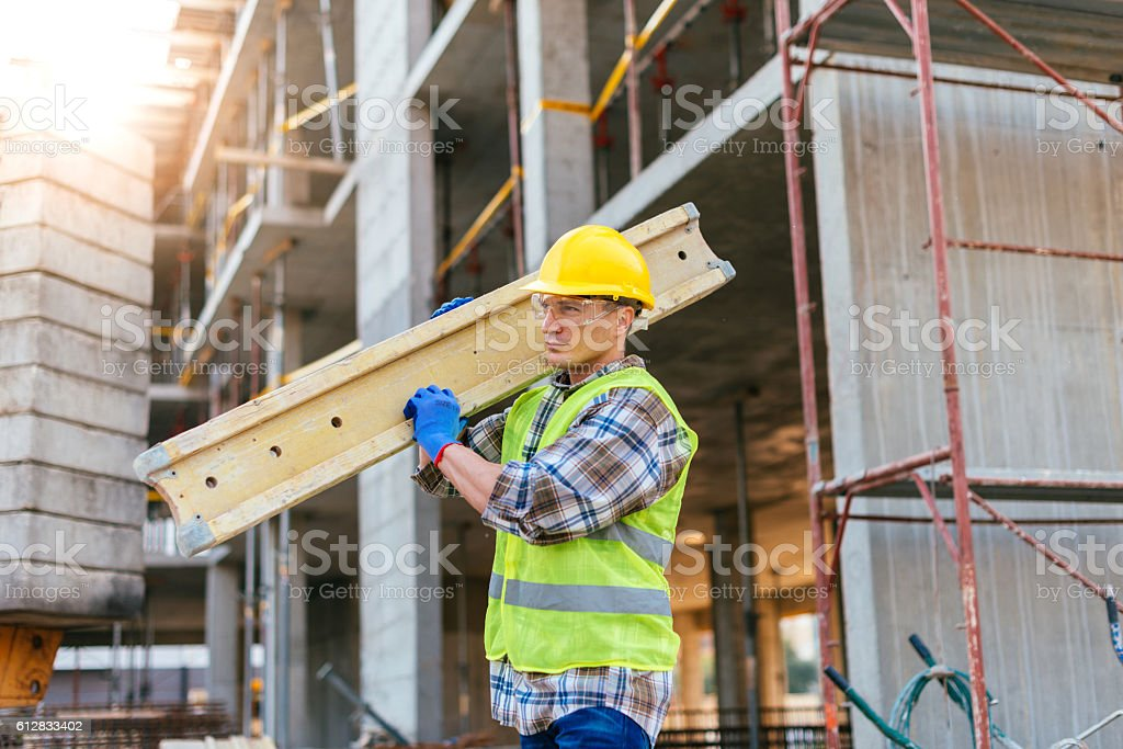 Hard working construction worker stock photo