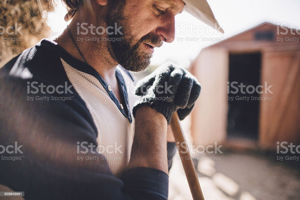 Hard working man takes break from manual labor stock photo