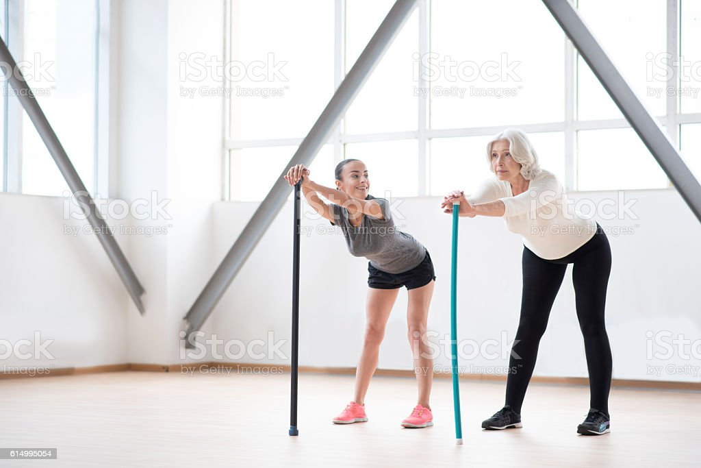 Hard working pleasant women training together stock photo