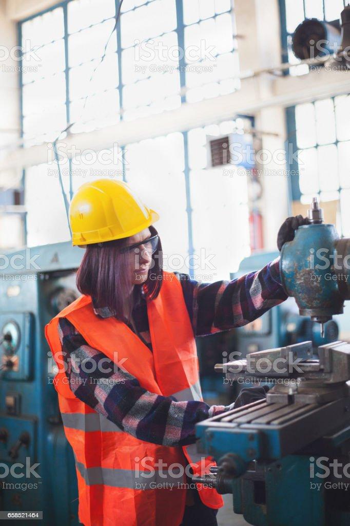 Hard working woman in metal industry stock photo