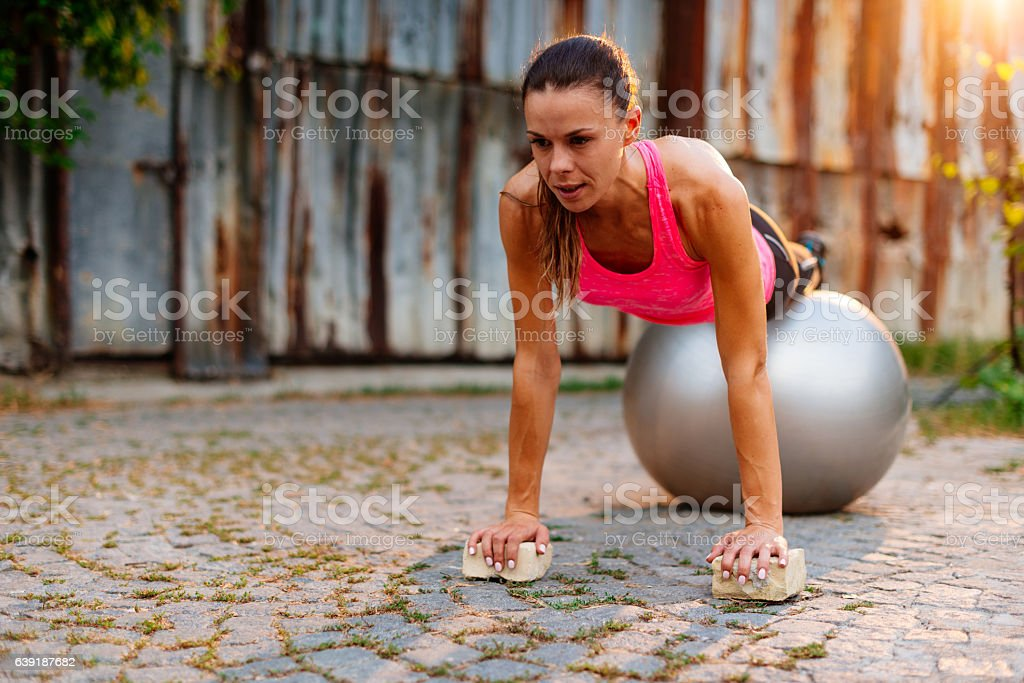 Hard workout for women with pilates ball stock photo