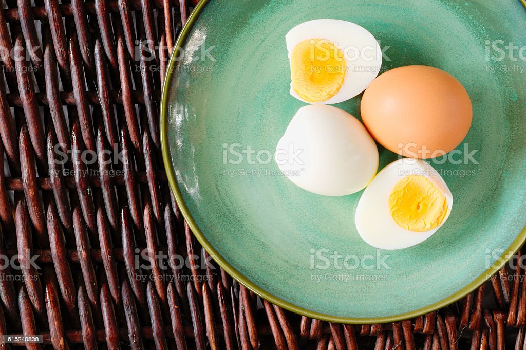 Hard-boiled egg cut and piled and with shell stock photo