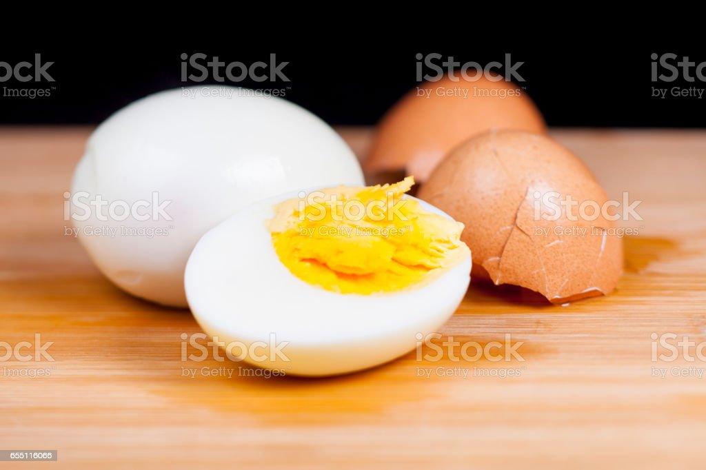 Hard-boiled egg on wood stock photo
