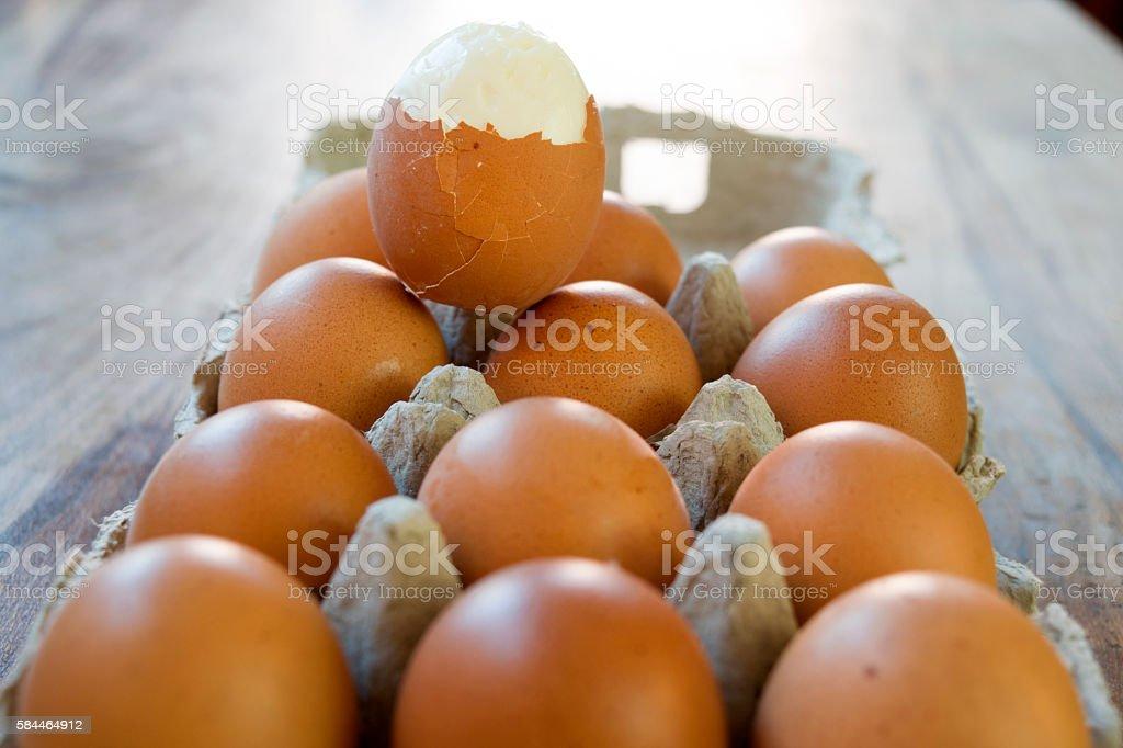 hardboiled egg partly shelled stock photo