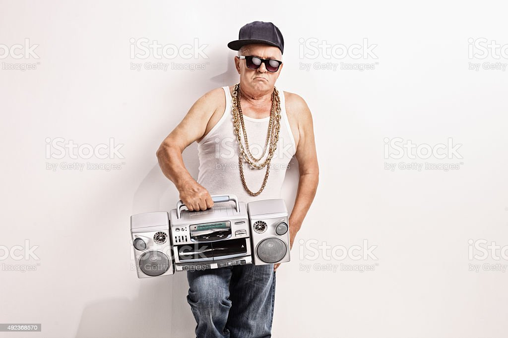 Hardcore senior rapper holding a ghetto blaster stock photo