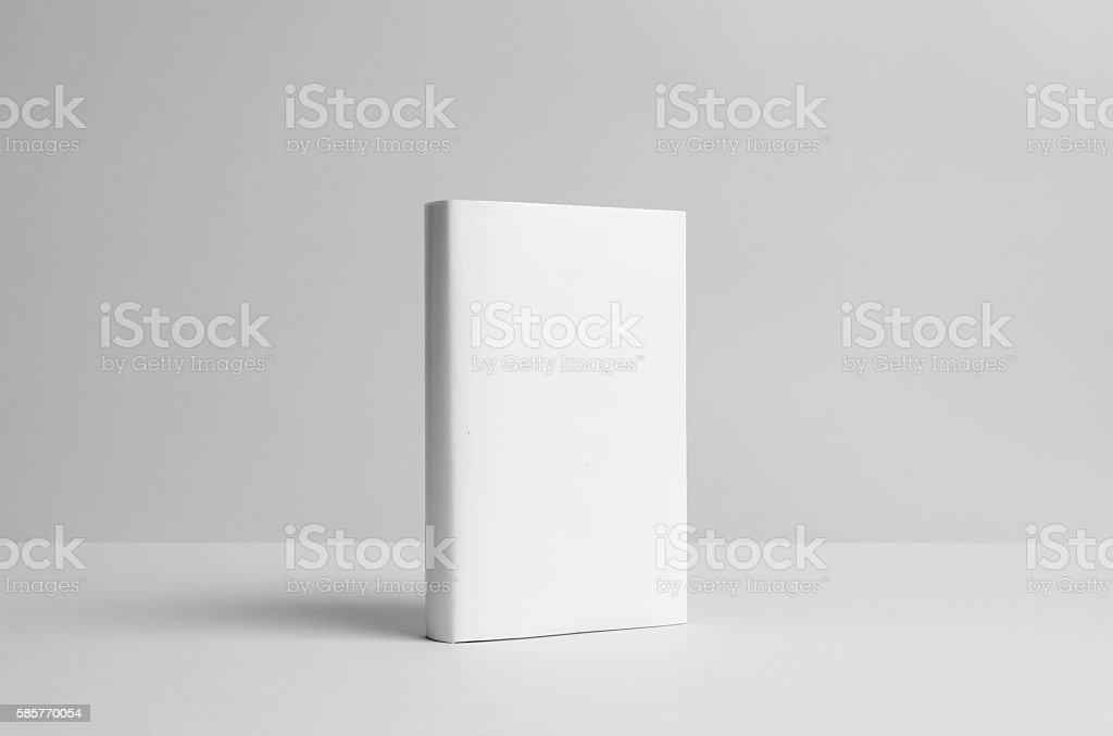 Hardcover Book Mock-Up - Dust Jacket. Front. Wall Background stock photo