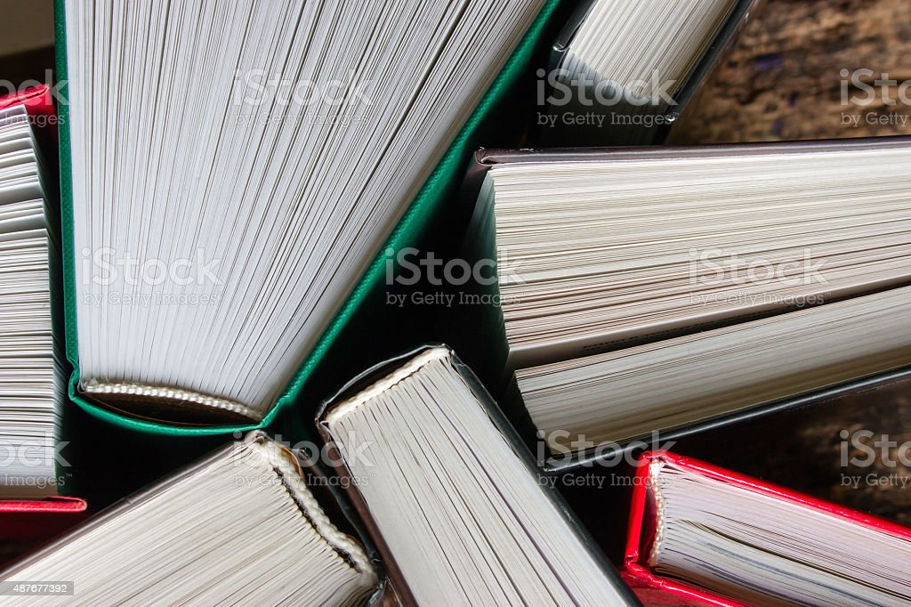 hardcover books top view of a wooden background stock photo