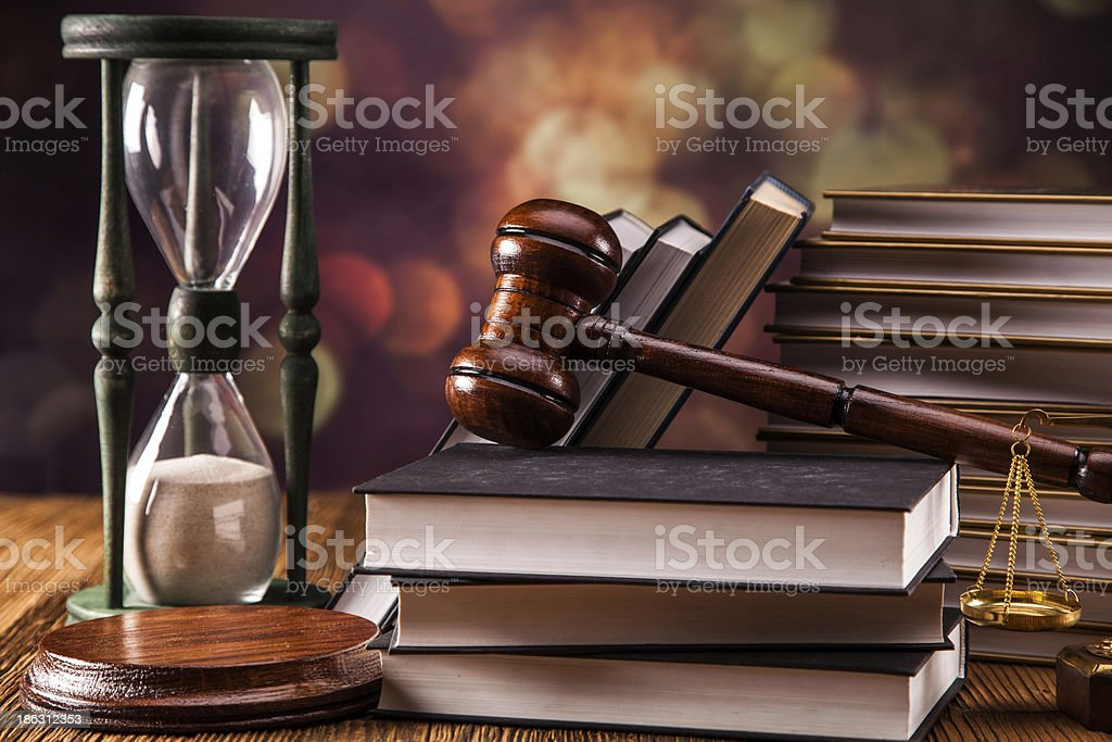 Hardcover books with wooden gavel and hourglass royalty-free stock photo