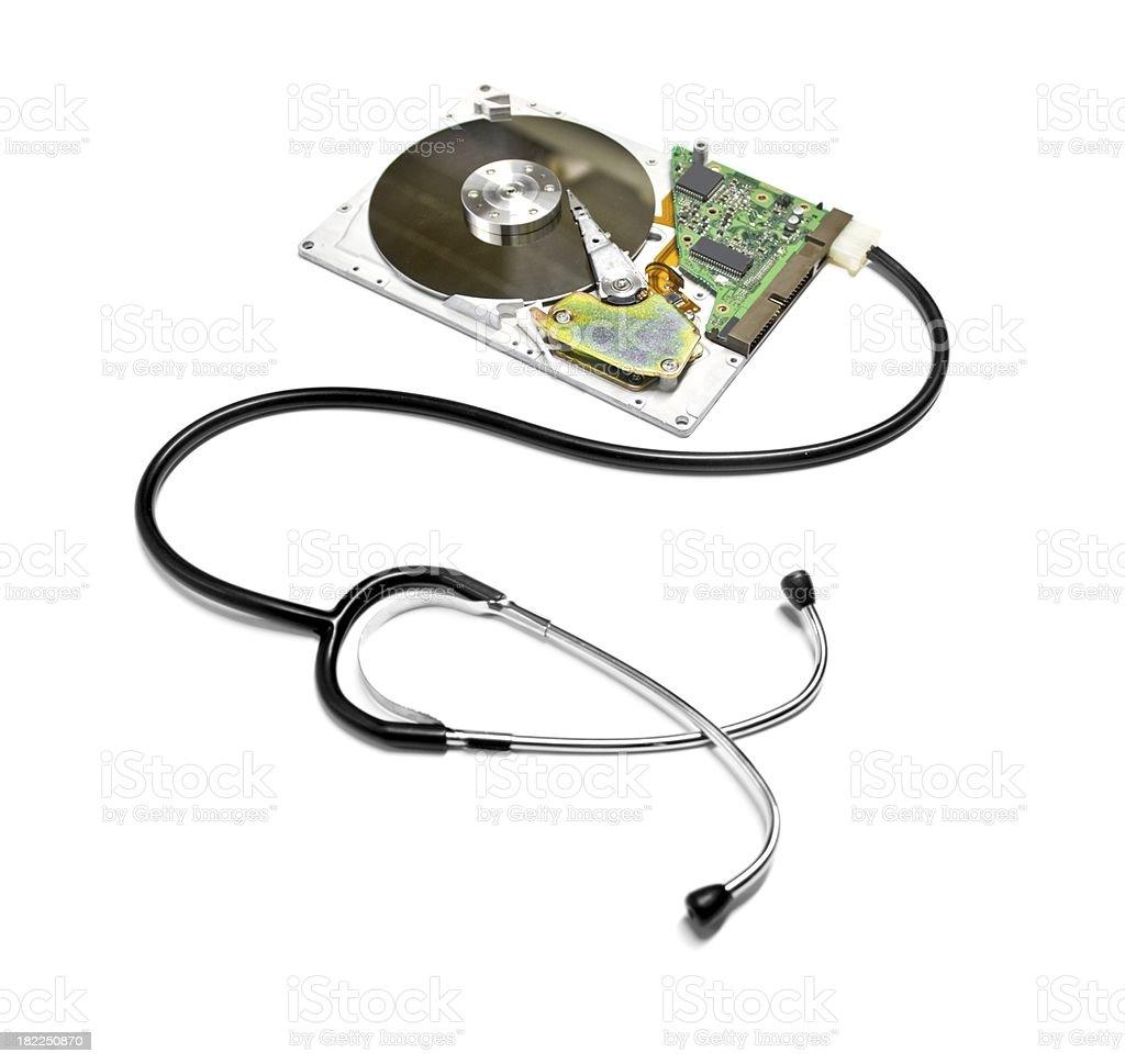 Harddisk and stethoscope Isolated on white royalty-free stock photo