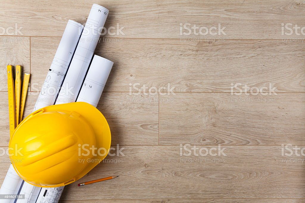 Hardhat and blueprint stock photo