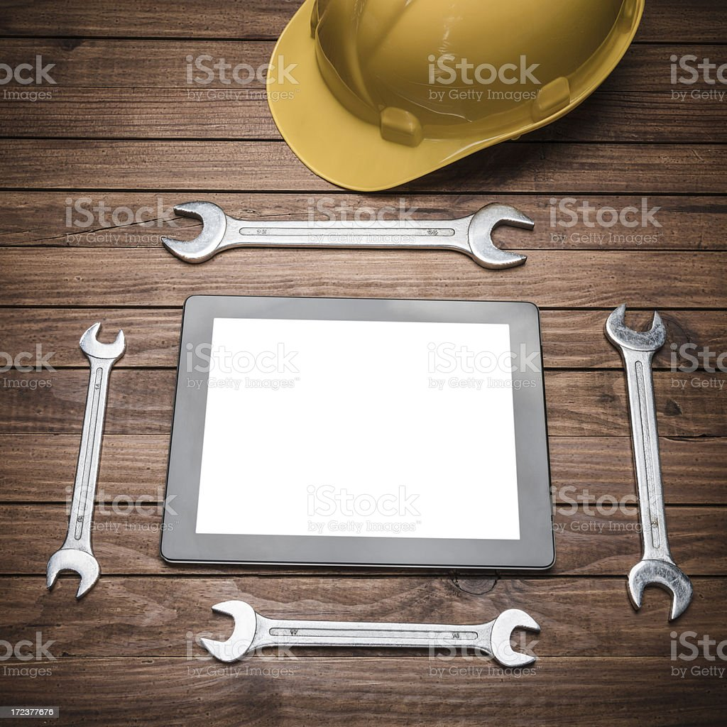 Hardhat and spanner with modern digital tablet royalty-free stock photo