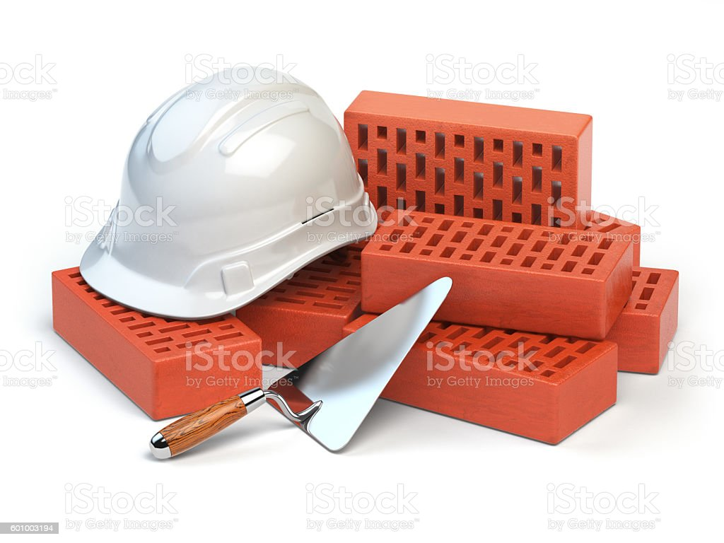 Hardhat,  bricks and trowel  isolated on white. Costruction conc stock photo
