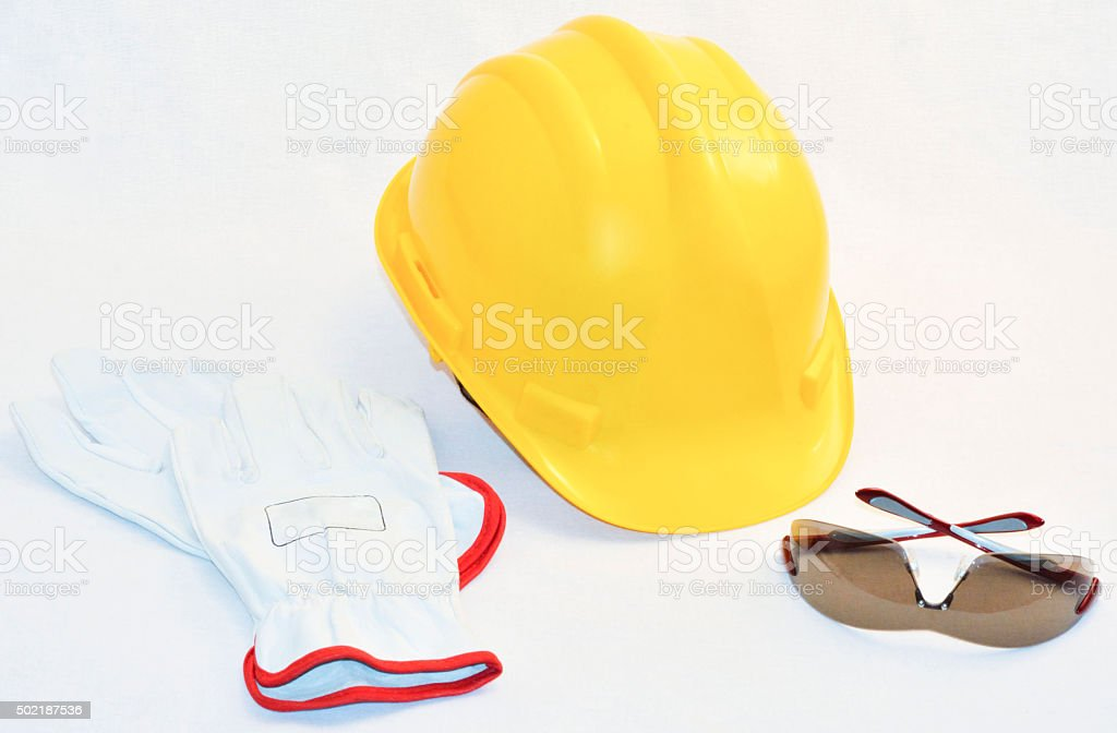 Hardhat, gloves and safety glasses on white background‏ stock photo
