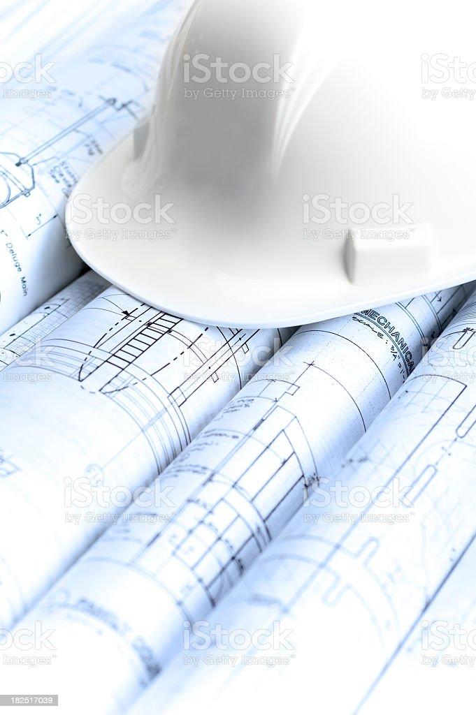 Hardhat on Blueprints royalty-free stock photo