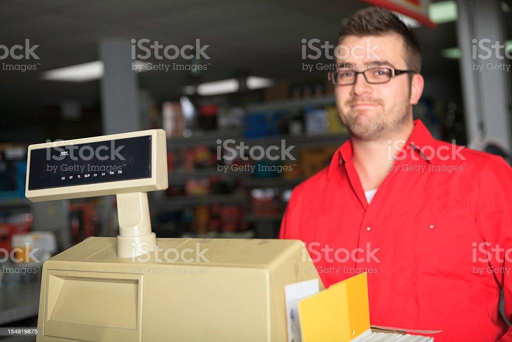 Hardware Store Cashier Focus on Cash Register royalty-free stock photo
