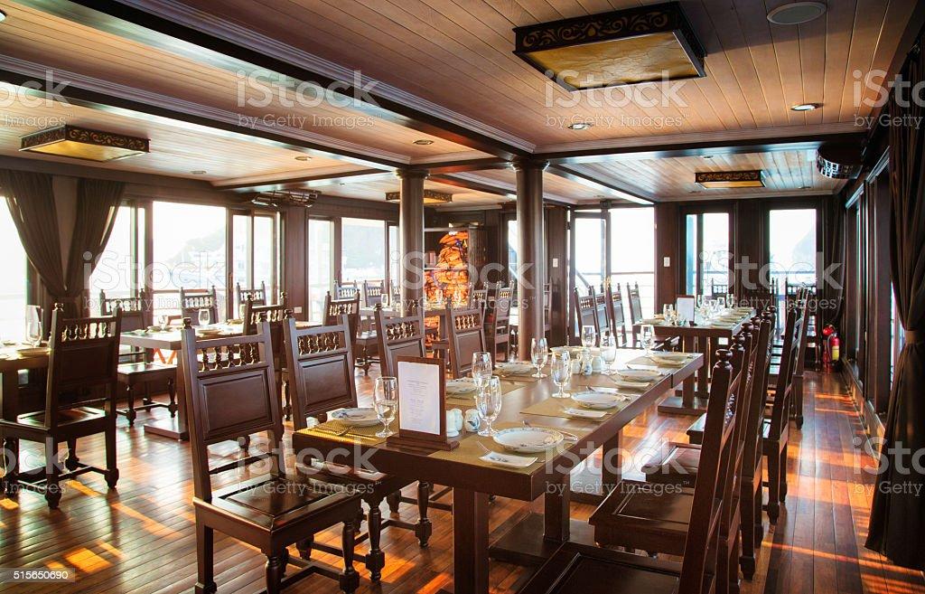 Hardwood dining room on Vietnamese cruise ship stock photo