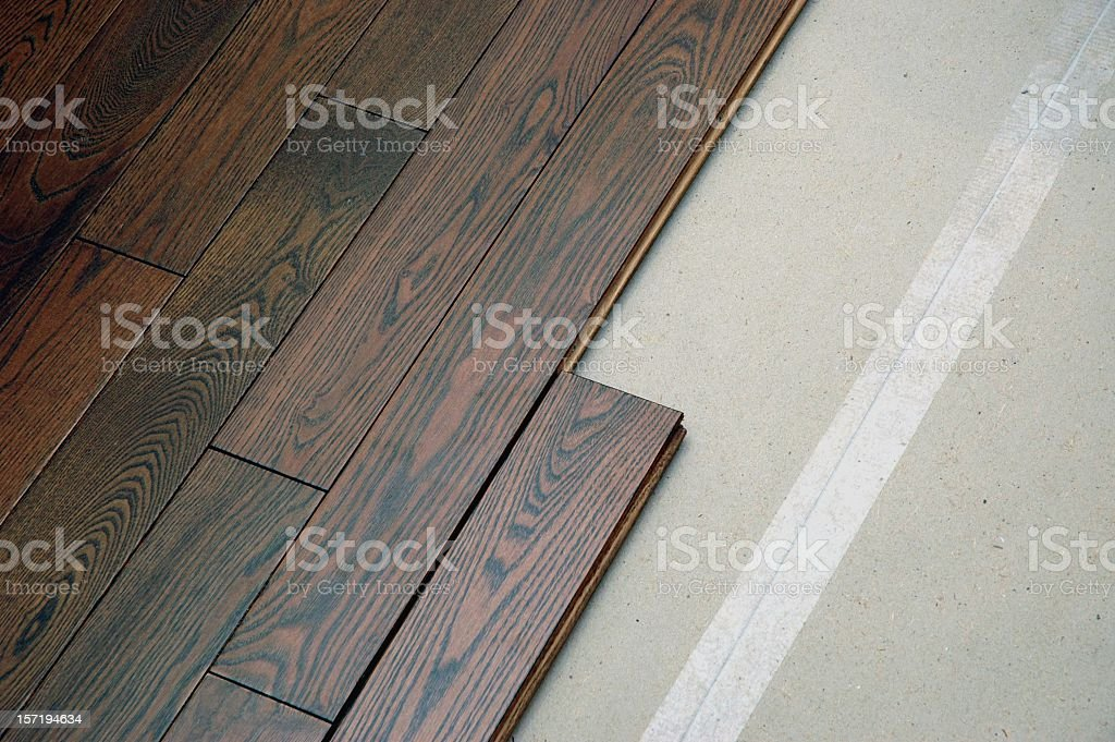 Hardwood floor in the installation process royalty-free stock photo