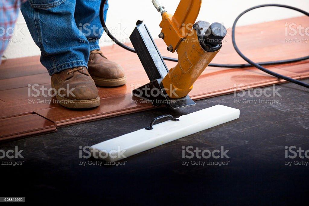 Hardwood Floor Installation in Progress stock photo