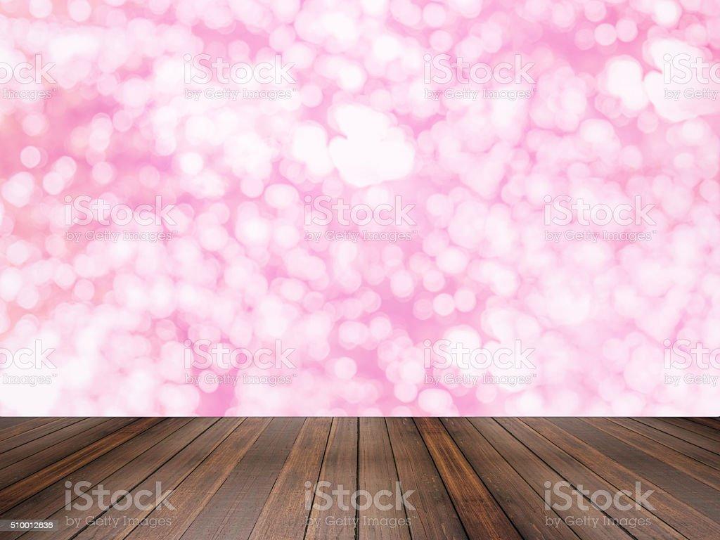 Hardwood floor with pink Bokeh background stock photo
