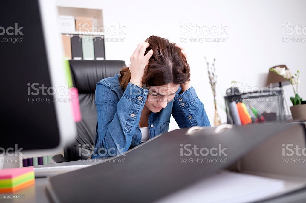 Hardworking dedicated businesswoman stock photo