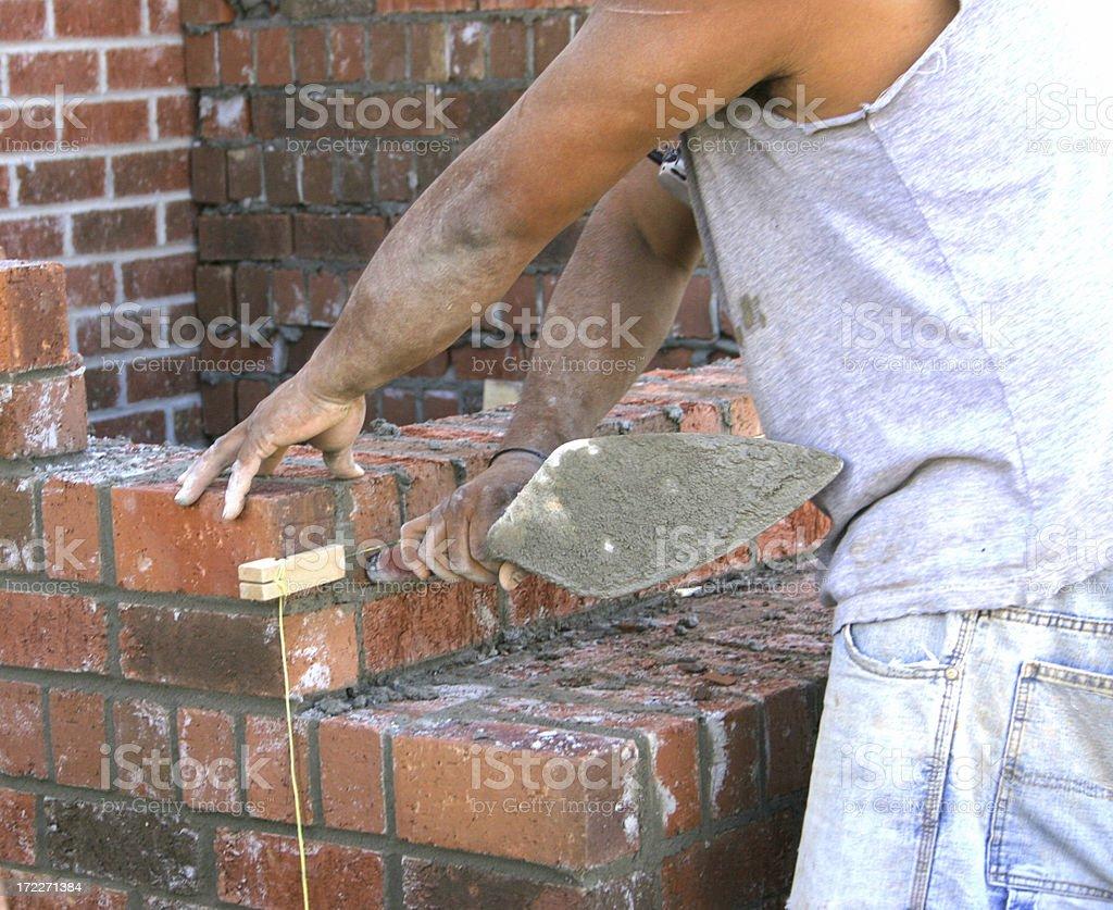 Hardworking mason stock photo