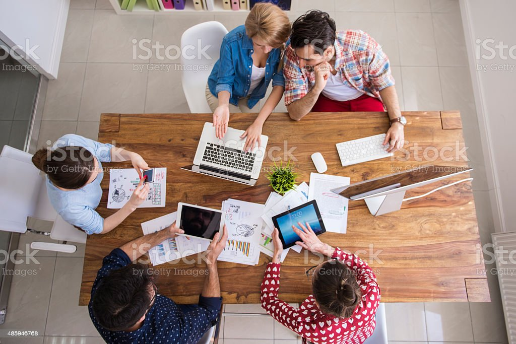 Hardworking team at their office table stock photo