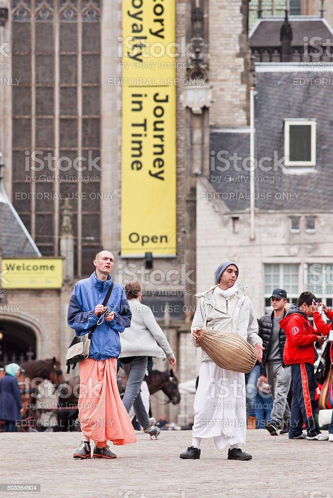 Hare Krishna people making music on Amsterdam Dam Square stock photo