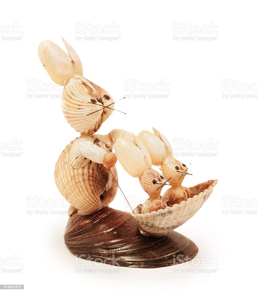 hares figurines made of shells stock photo
