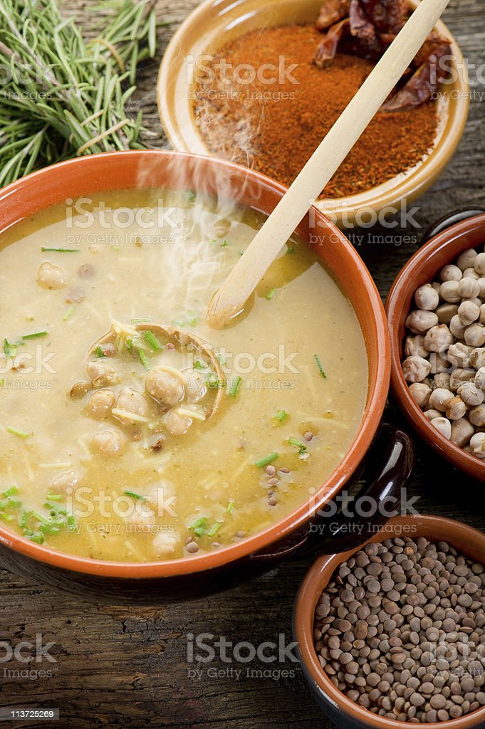 Harira soup with ingredients on wooden table stock photo