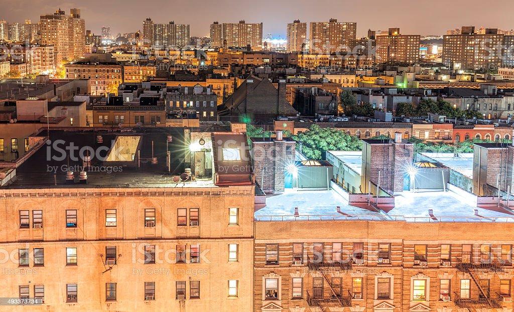 Harlem neighborhood at night, NYC, USA. stock photo