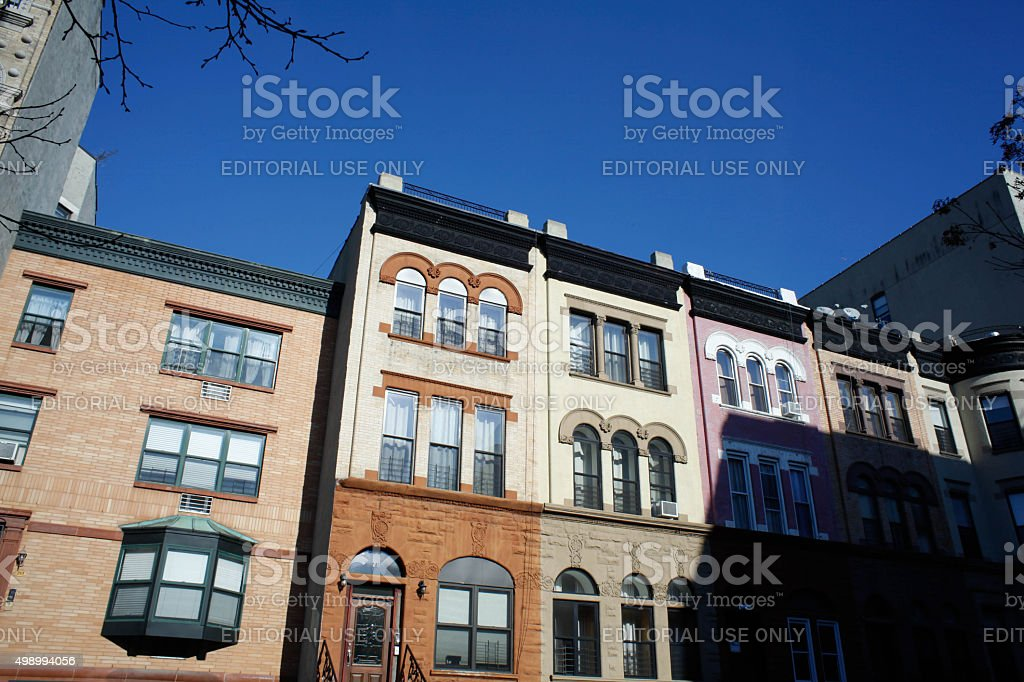 Harlem real estate. Pastel brownstone in Harlem. stock photo
