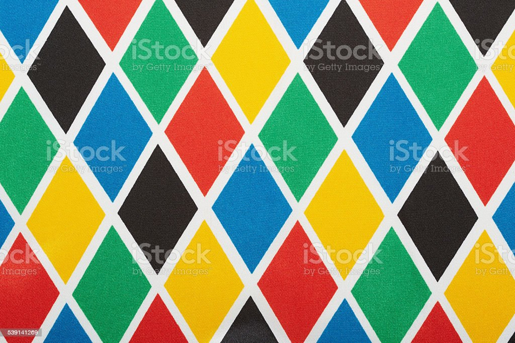 Harlequin colorful diamond pattern background stock photo