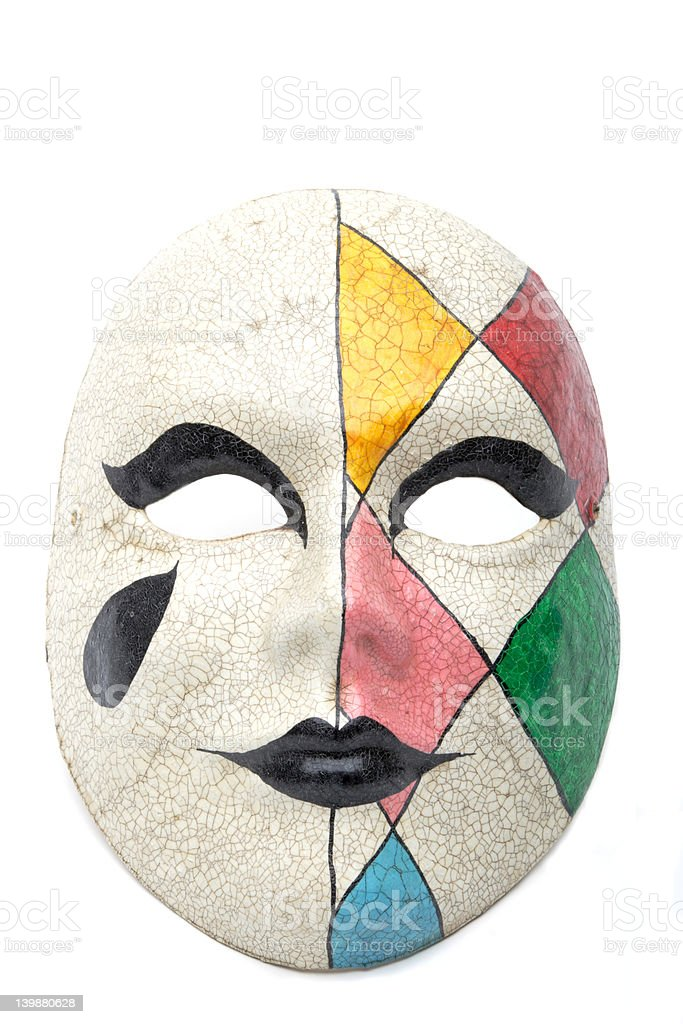 harlequin mask on white stock photo