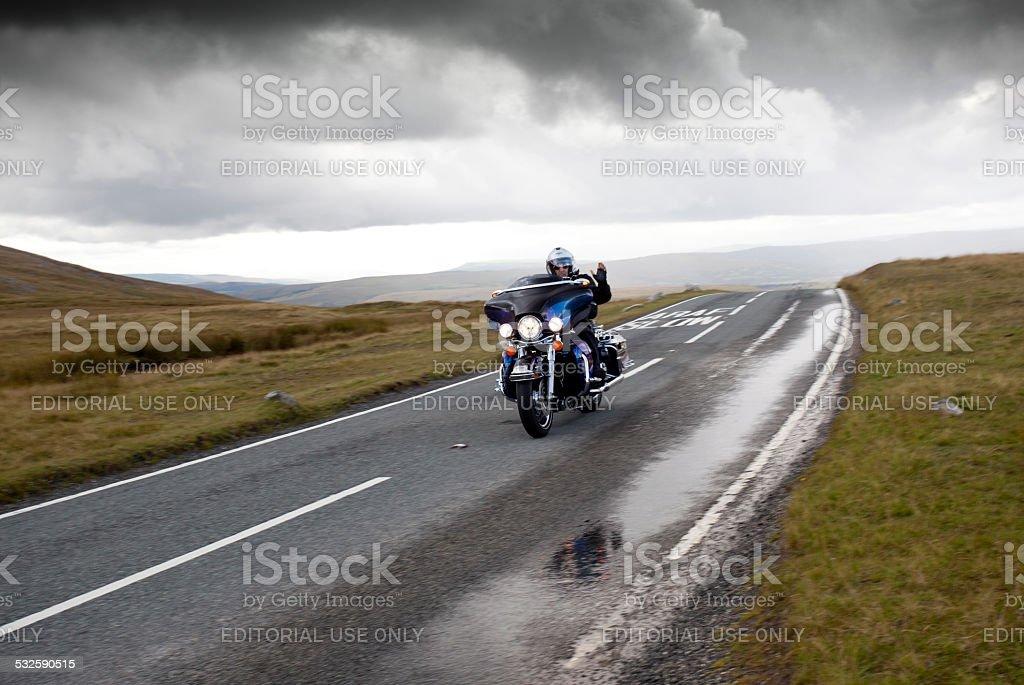 harley davidson motorbike on mountain road stock photo