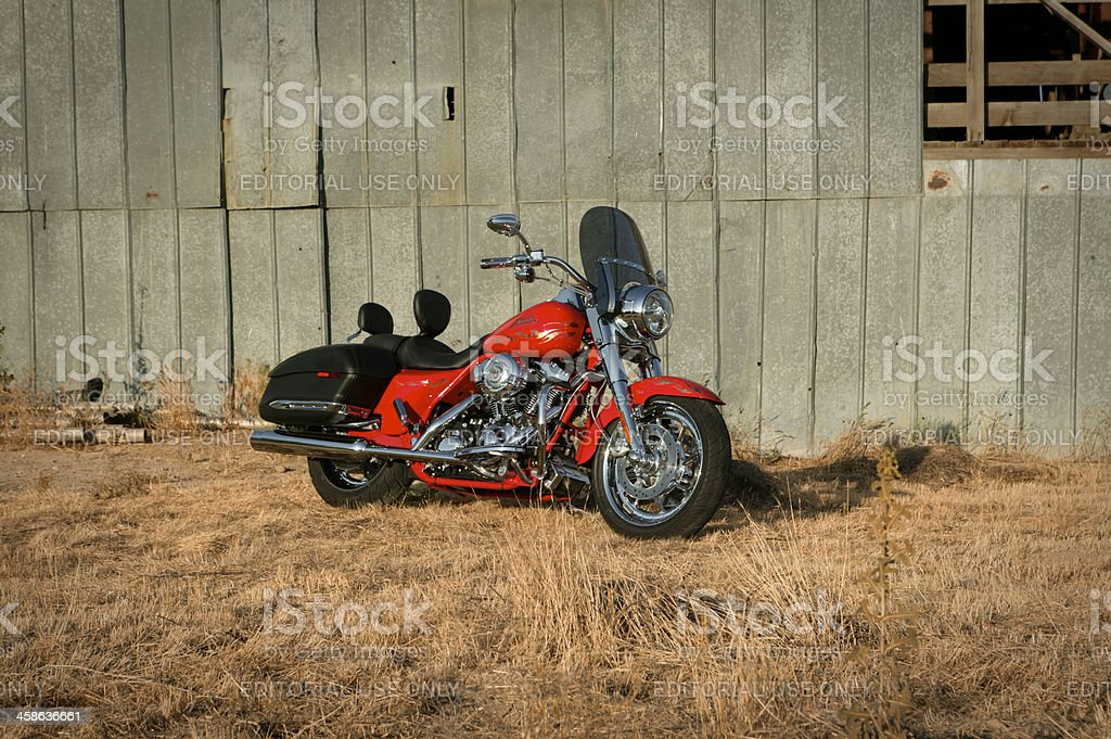 Harley parked on road side horizontal royalty-free stock photo