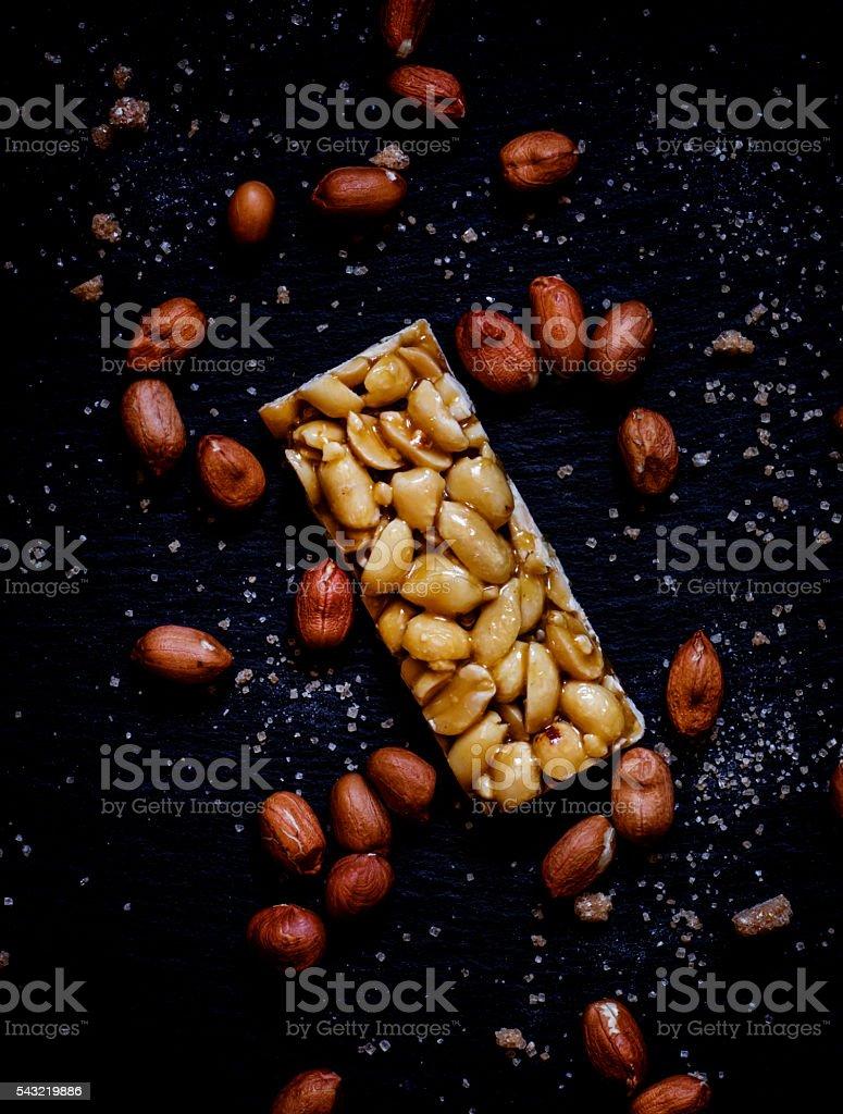 Harmful dessert peanuts in caramel stock photo