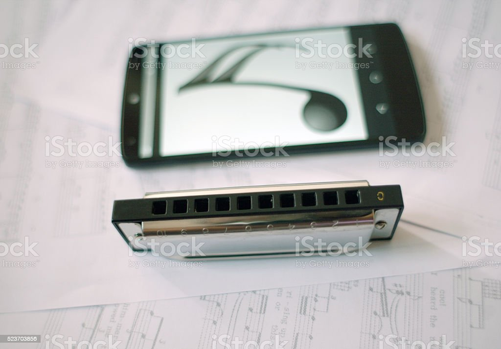 Harmonica and phone stock photo