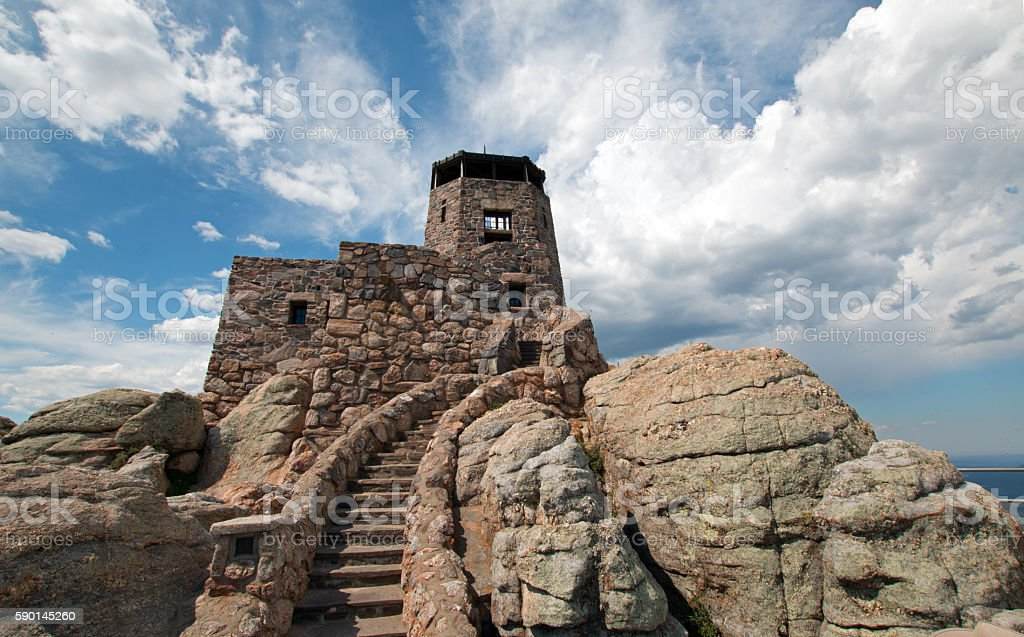 Harney Peak Fire Lookout Tower stone steps under cirrus cloudscape stock photo