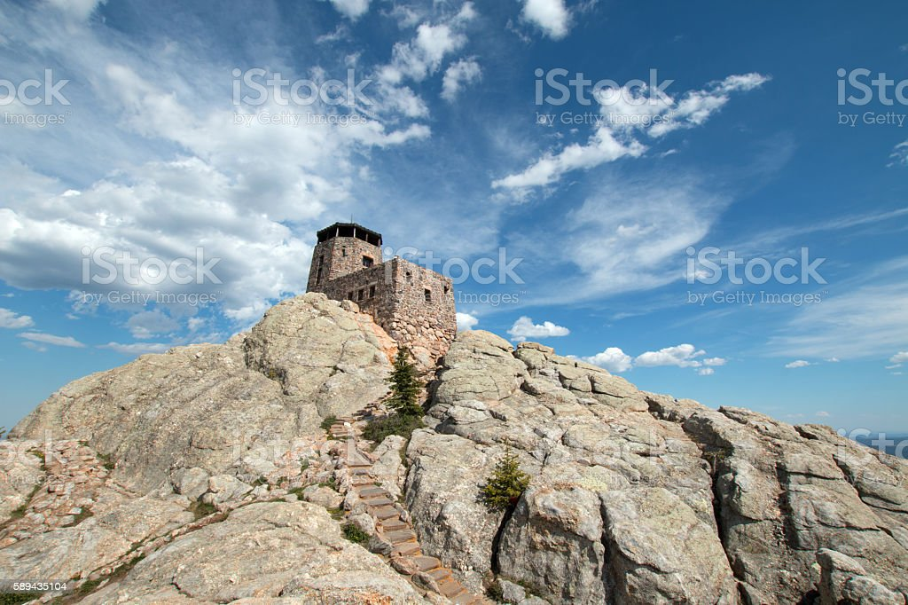 Harney Peak Fire Lookout Tower under cirrus cumulus clouds stock photo