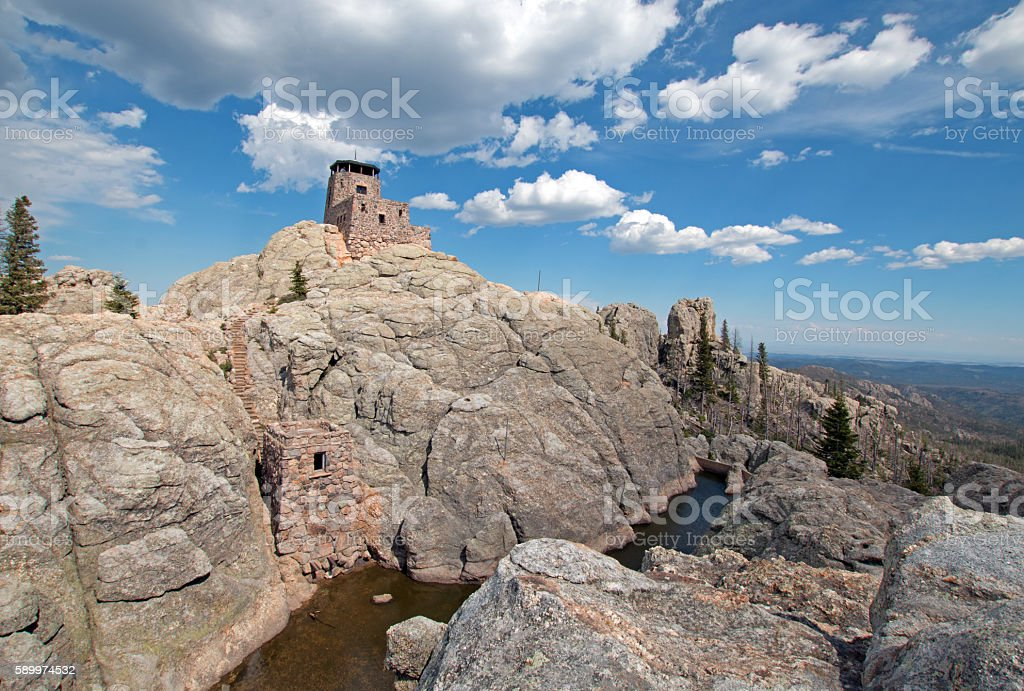 Harney Peak Lookout Tower and pumphouse with small dam USofA stock photo