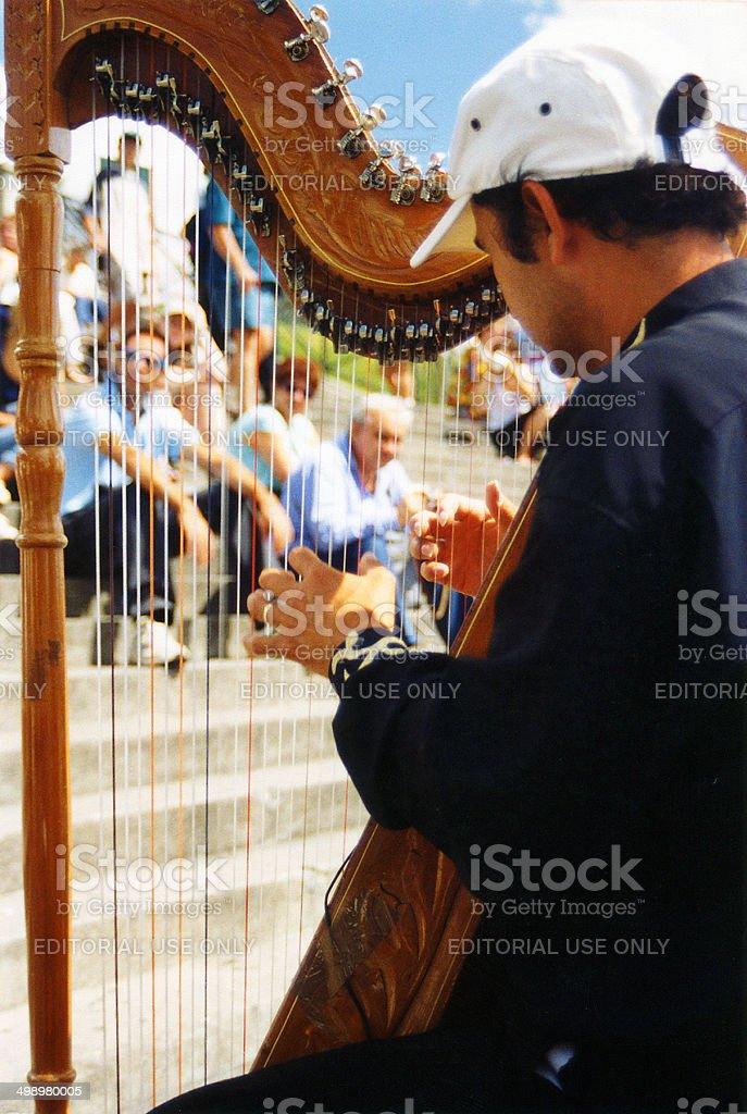 Harp Player in Paris stock photo