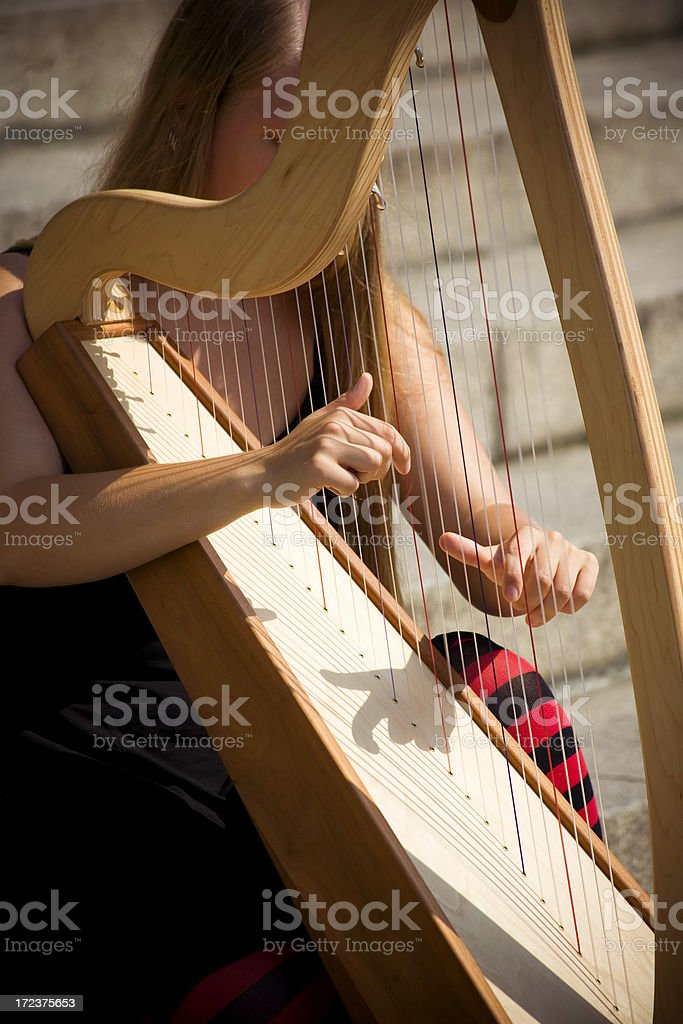 harp player royalty-free stock photo