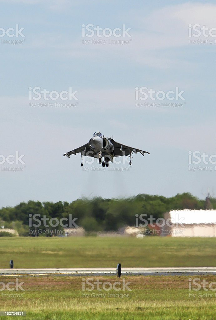 Harrier Jet Hovering Above Ground royalty-free stock photo