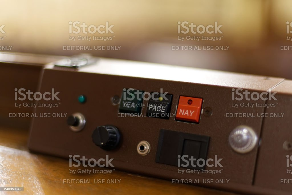 Harrisburg, PA, USA - December, 19, 2016; 'YEA' and 'NAY' voting buttons are found on the console of a House representative at the State Capitol in Harrisburg, Pennsylvania. stock photo