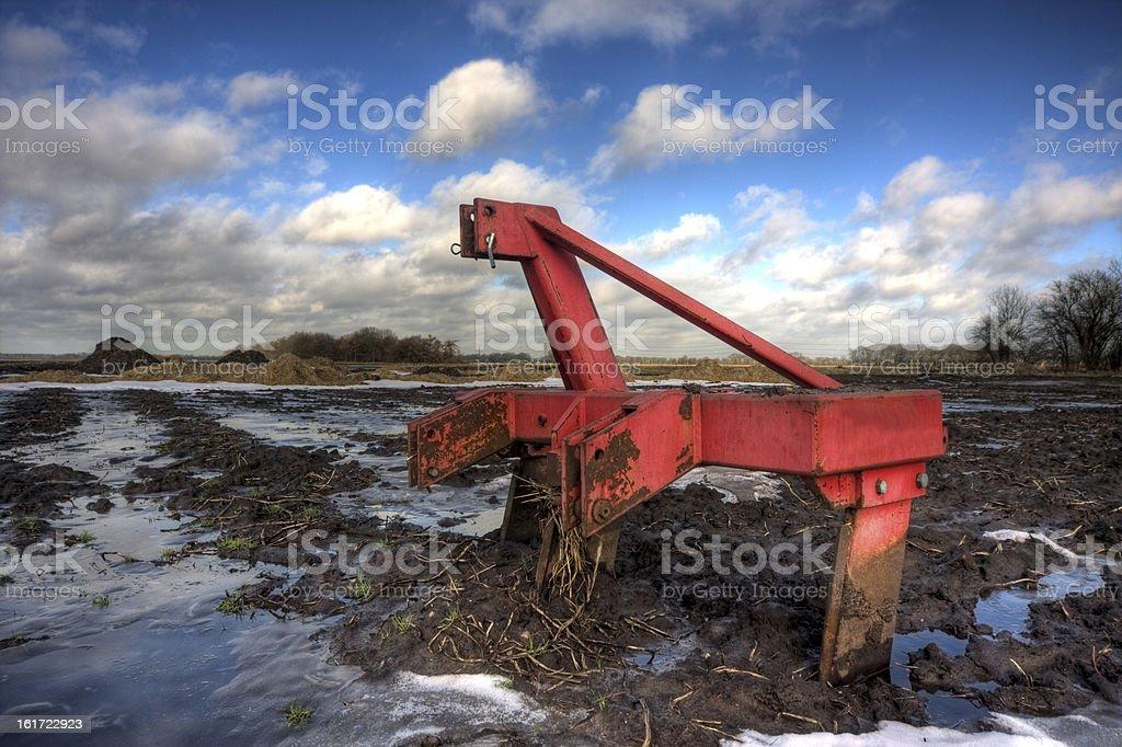 Harrow in mud royalty-free stock photo