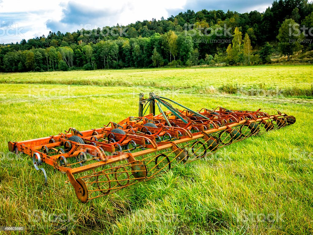 Harrow on a cultivated field stock photo