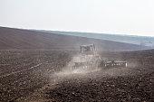Harrowing the soil with disc harrows
