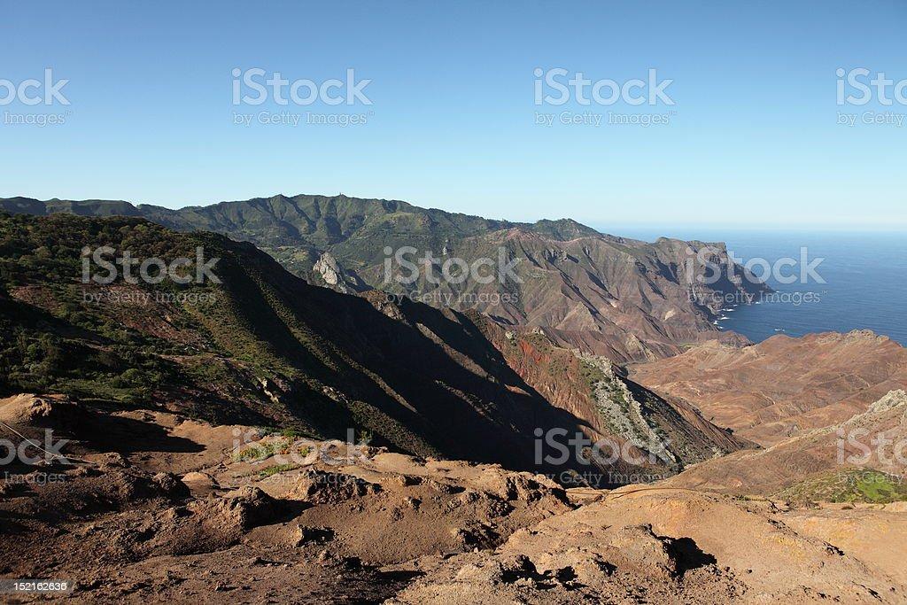 Harsh volcanic landscape of Sandy Bay on St Helena Island stock photo