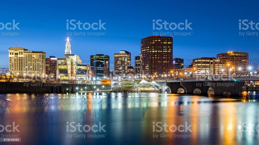 Hartford skyline and Founders Bridge at dusk stock photo