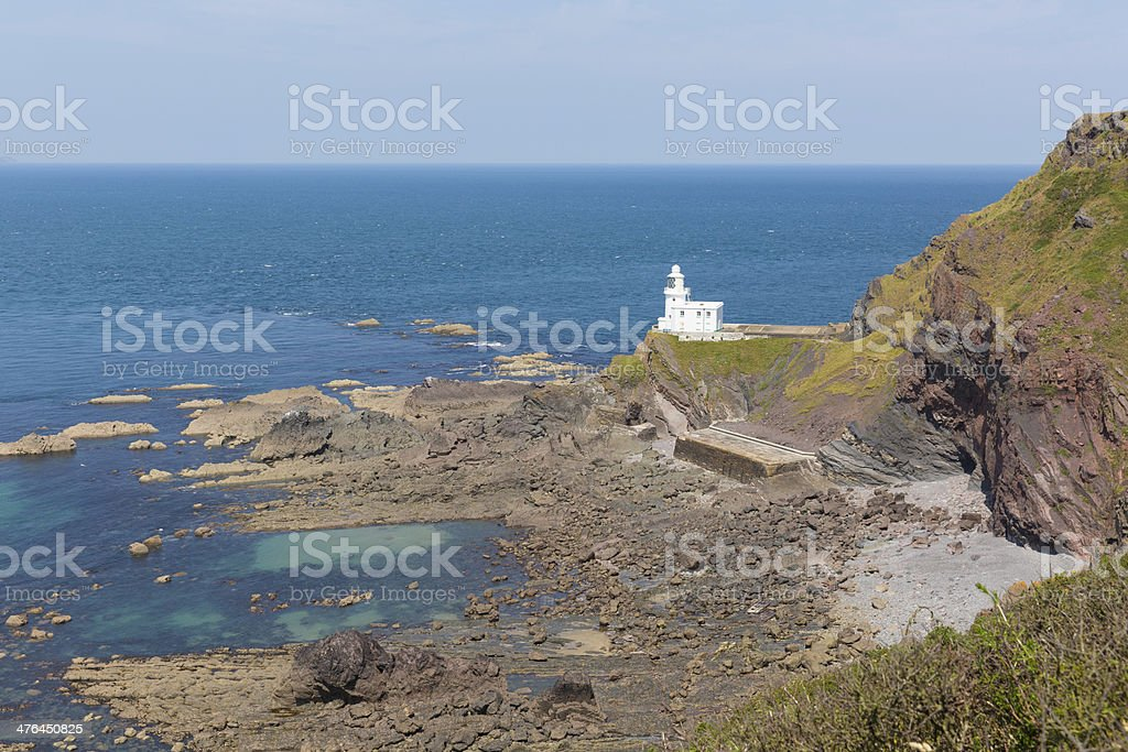 Hartland Point lighthouse Devon England with blue sea royalty-free stock photo